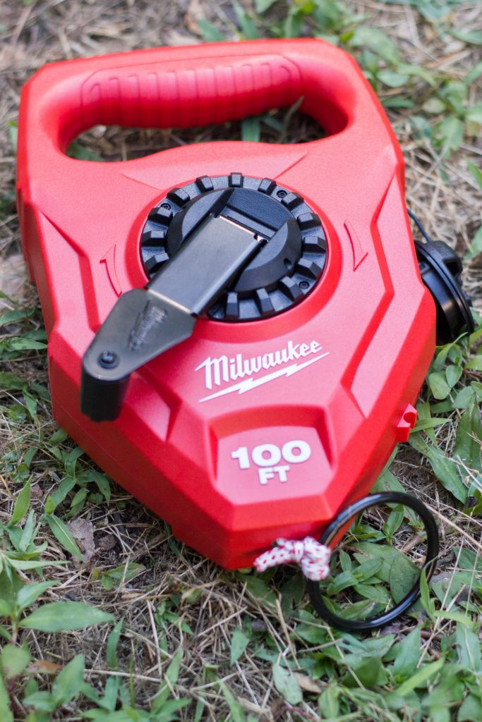 This Milwaukee large capacity chalk reel comes in handy for outdoor projects! We used it to mark off the area where we wanted to create a garden bed.