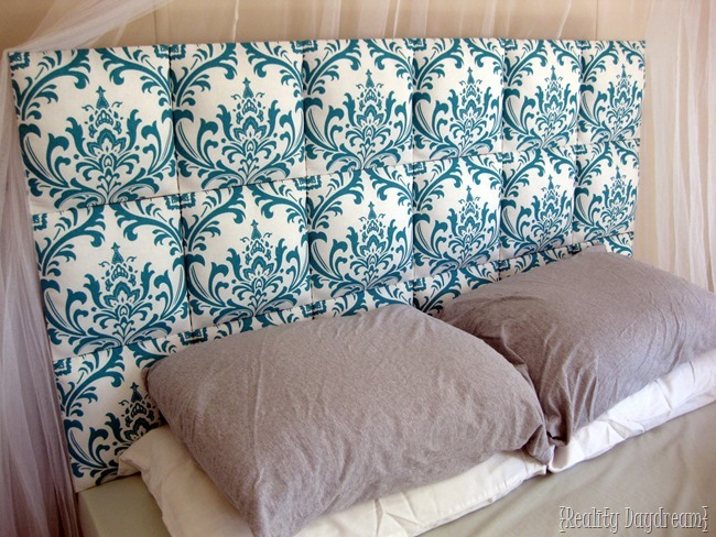 Individual-upholstered-squares-lined-up-to-make-a-tufted-DIY-headboard-Reality-Daydream_thumb
