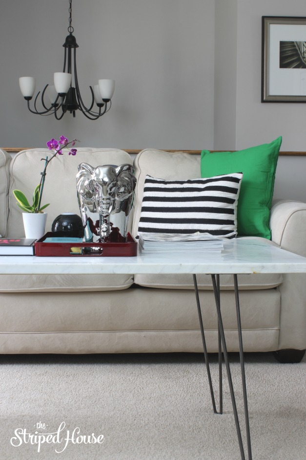 DIY Marble Coffee Table by The Striped House, featured at #DIYLikeaBoss.