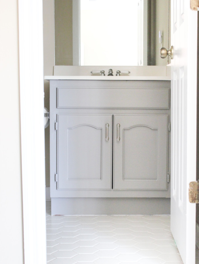 Tips for Painting a Bathroom Vanity {& Our Playroom Bathroom}