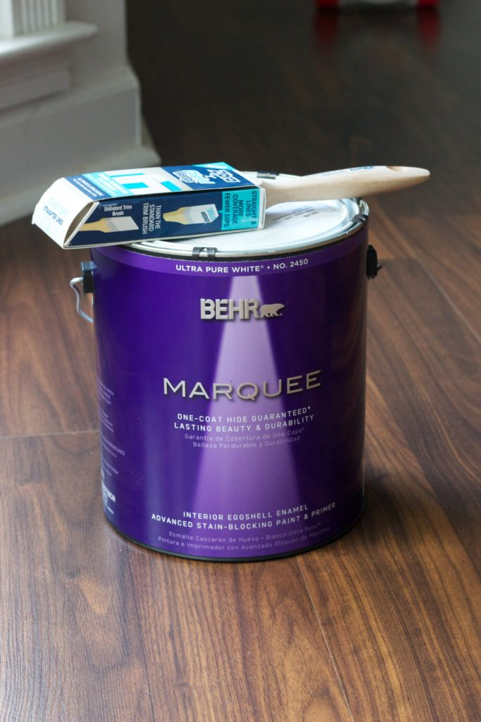 Behr Marquee in White 52 and the Zibra Chiseled Wedge Brush are the perfect combo for a brick fireplace makeover.