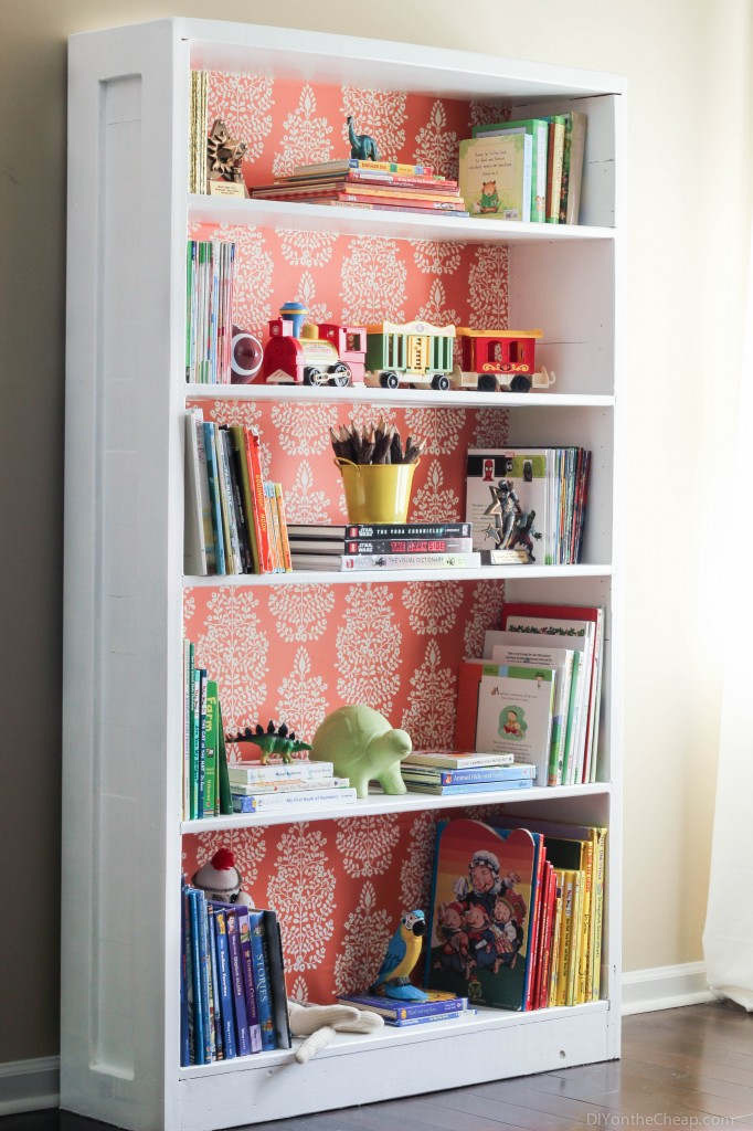 Bookshelf Makeover: Use removable wallpaper to customize it!