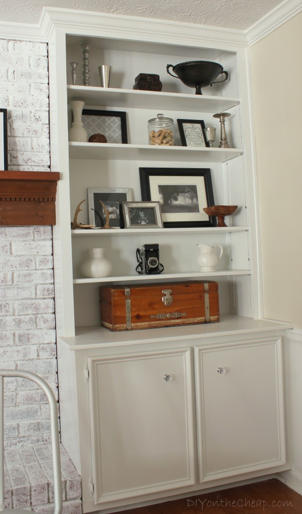 Styled Built-ins and diamond-cut acrylic cabinet knobs