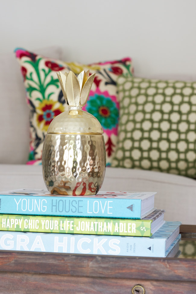 Find out about the history of pineapples as a symbol of hospitality + 8 Pineapple Home Decor Items via ErinSpain.com.