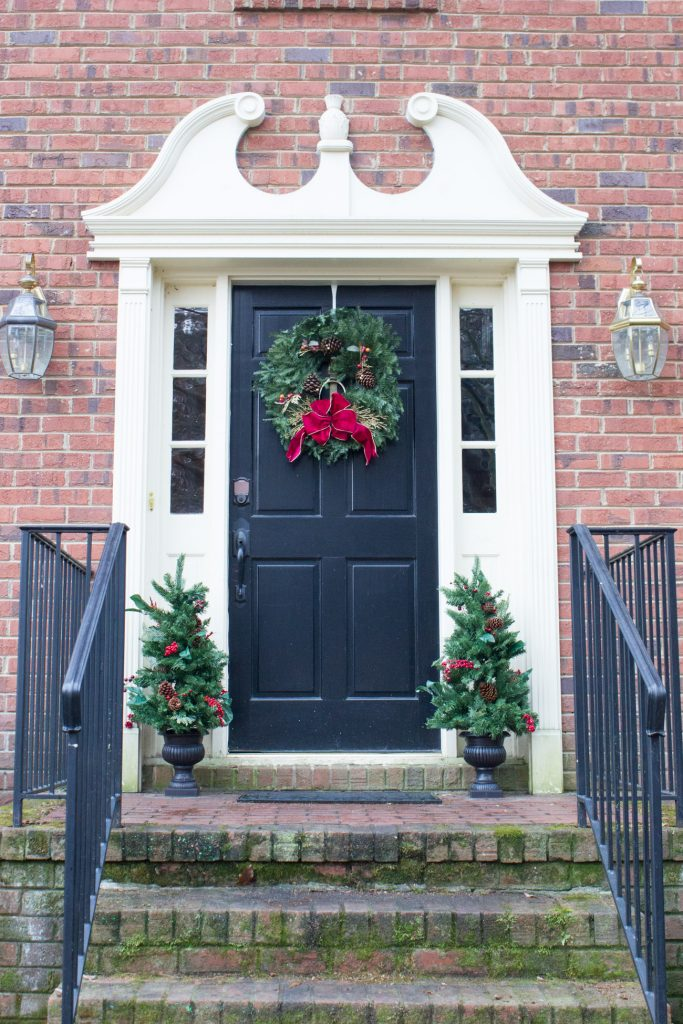 This Christmas porch is just one of many featured in the #welcomehometour! Stop by to see more Christmas decorating inspiration.