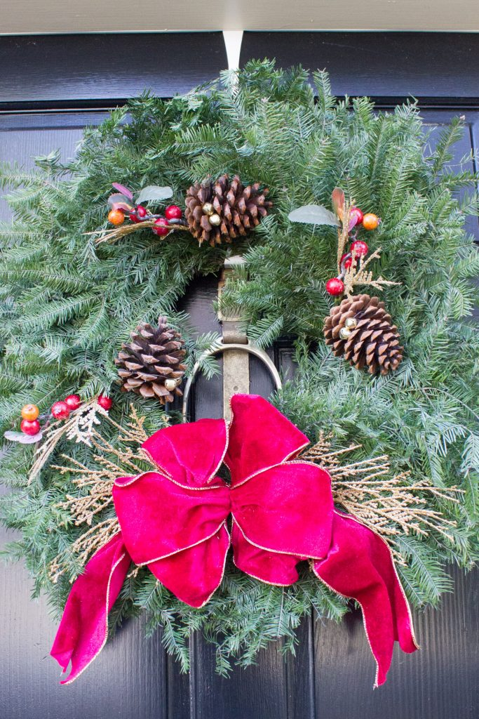 I love displaying a fresh Christmas wreath on the front door each year.