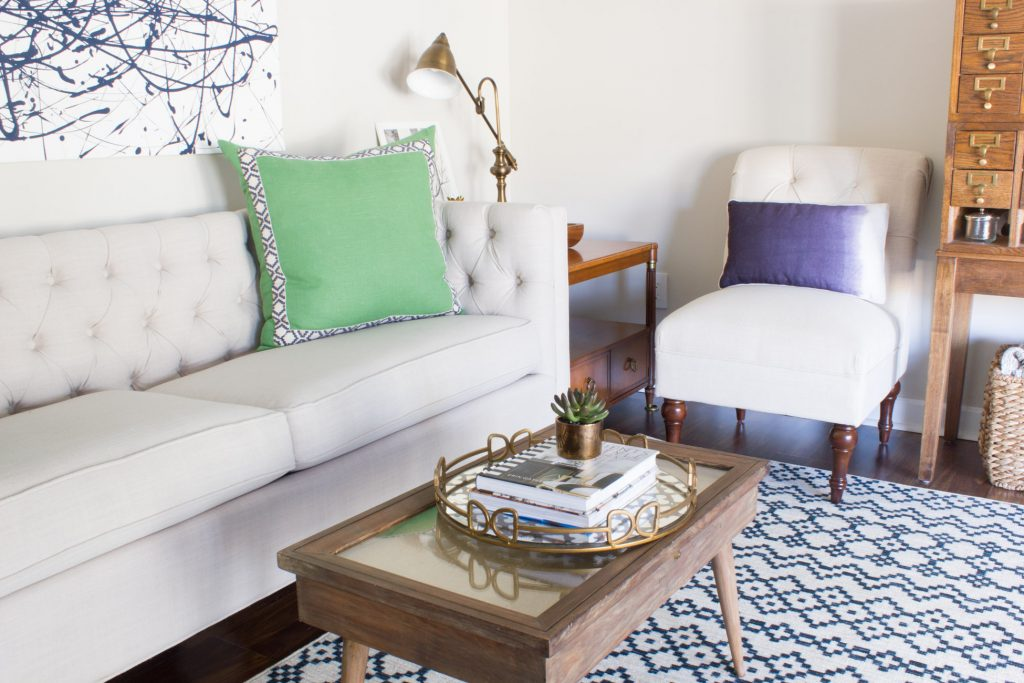 Loving this mom cave living room! Especially the rug and that Sumatra Indigo pillow!