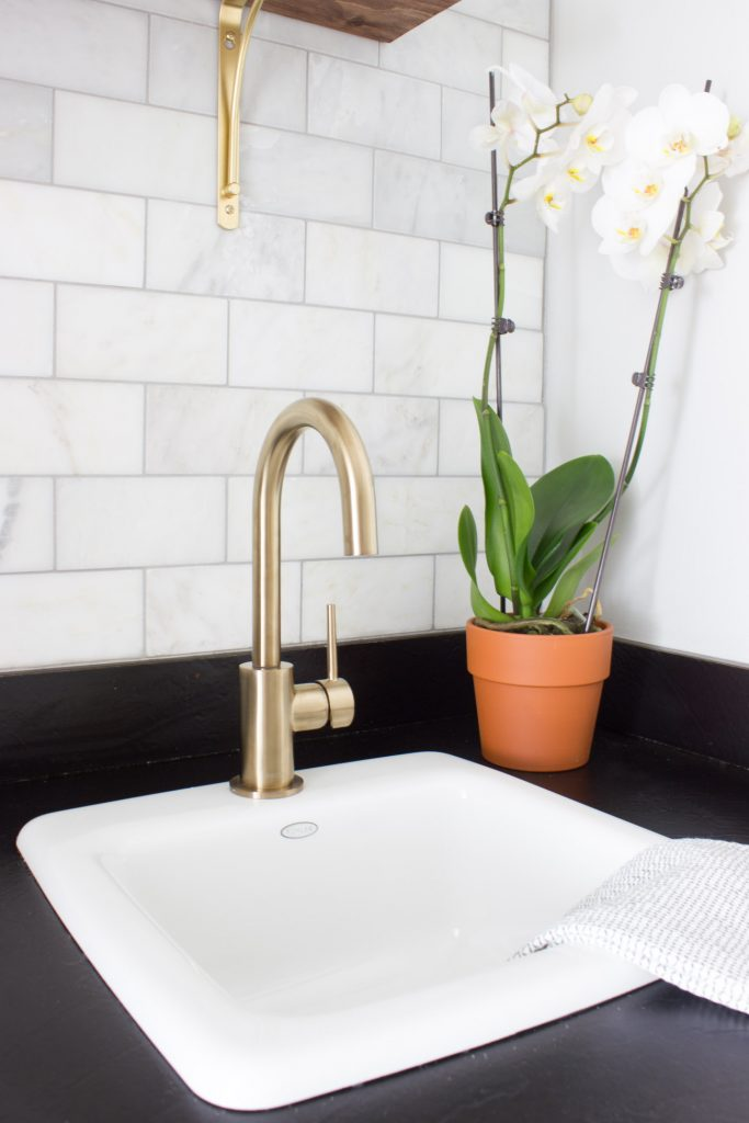 This is stunning! This 80s wet bar/butler's pantry was transformed into a gorgeous, modern coffee bar for the One Room Challenge. You HAVE to see the before and after! What a dramatic transformation! This Delta Trinsic Bar Prep faucet in Champagne Bronze is beautiful.