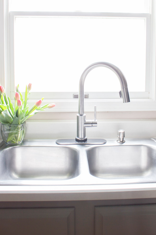 new delta trinsic faucet for the kitchen - erin spain