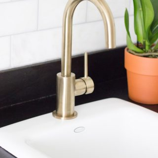 This coffee bar features the Delta Trinsic Bar Prep Faucet in Champagne Bronze, and it is gorgeous!