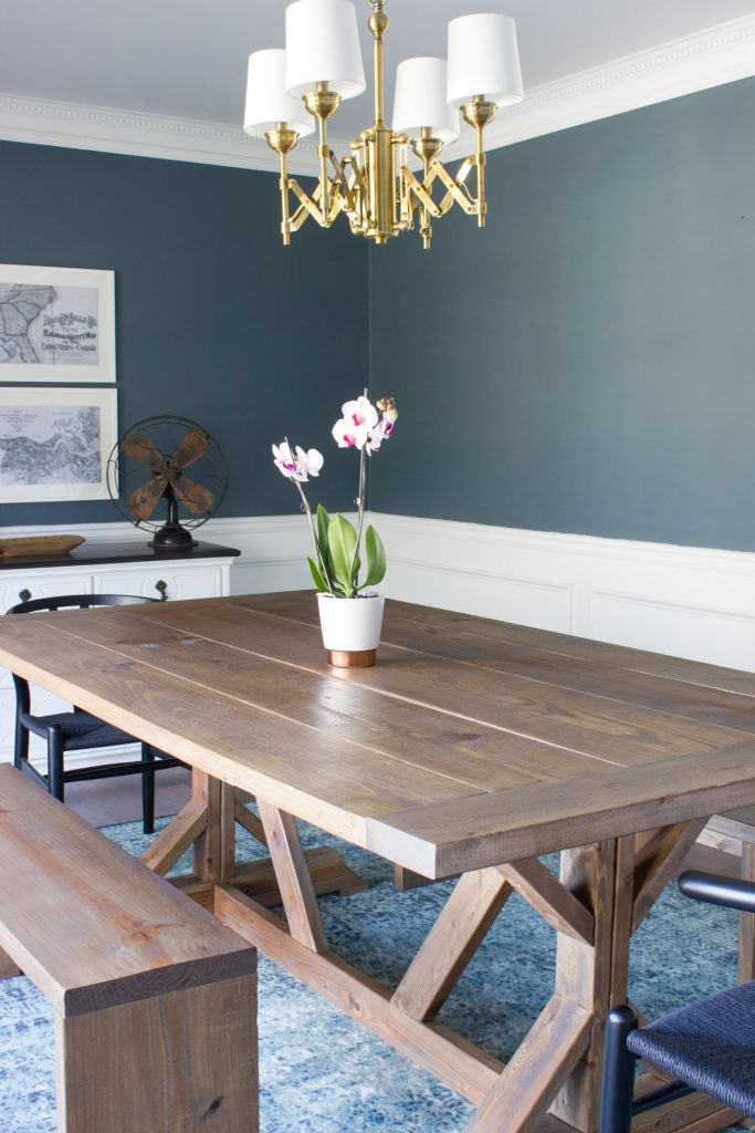 I'm in love with this DIY modern farmhouse dining table and benches! Plus she created a custom stain. So pretty!