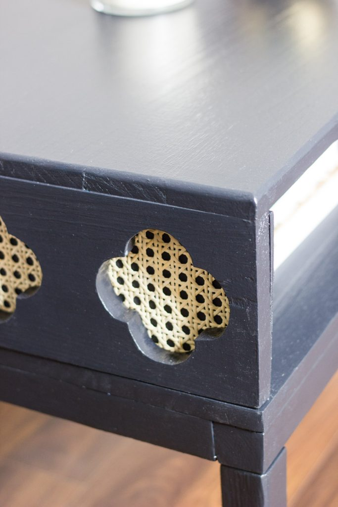 Learn how to make this DIY coffee table with cane clover (or quatrefoil) shaped cut-outs!