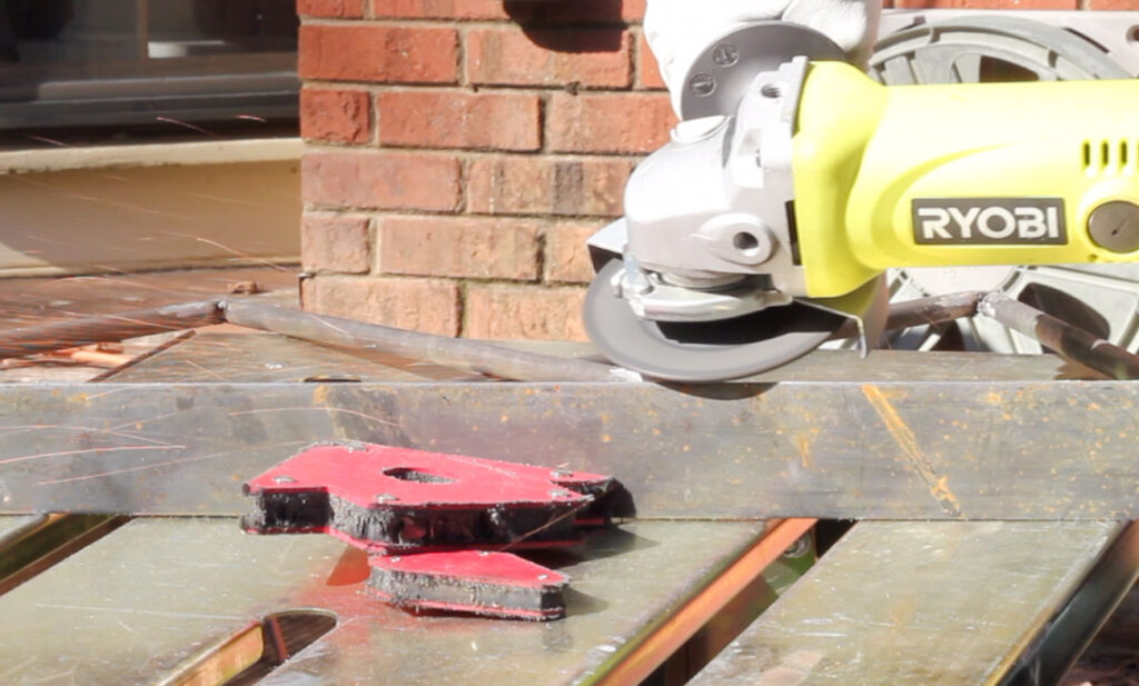 Grinding steel with a RYOBI angle grinder.