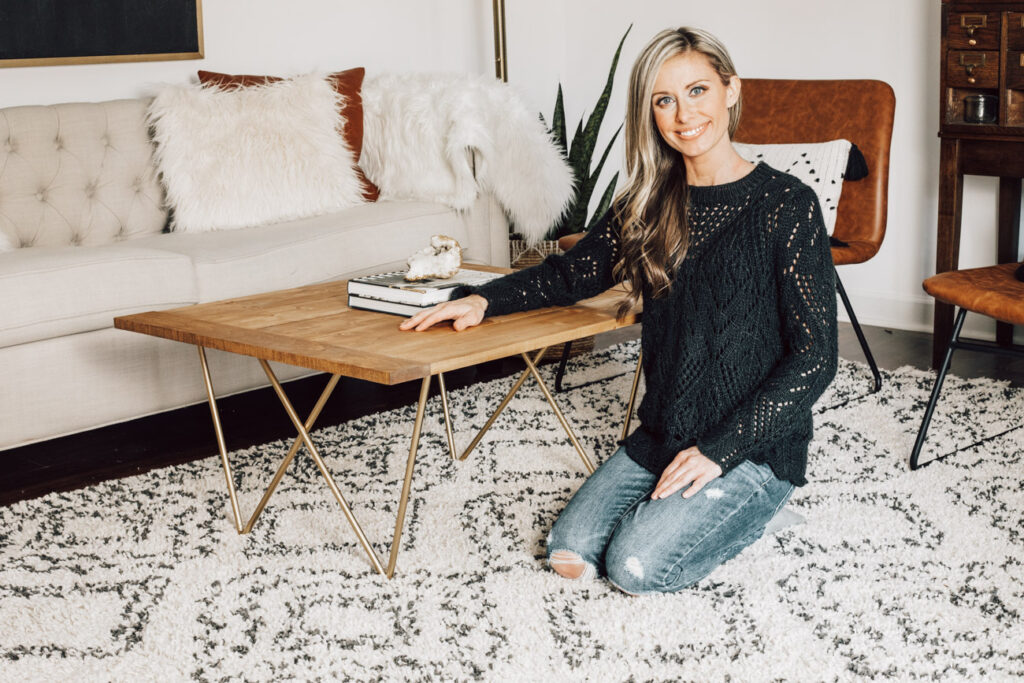 Erin Spain and her DIY coffee table with welded steel legs.