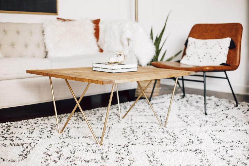 DIY coffee table with welded steel legs.