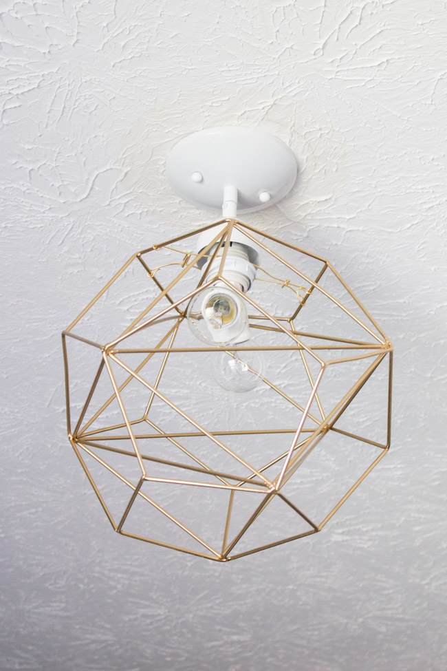I'm in love with this DIY geometric light fixture.