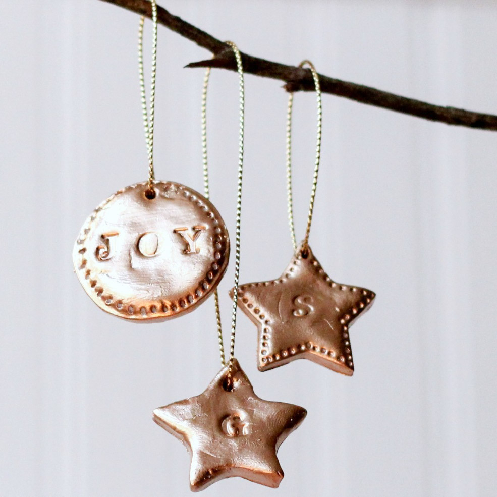 These DIY Hand-Stamped Clay Ornaments are beautiful and easy to make, plus they would make a great Christmas gift! Love these so much.