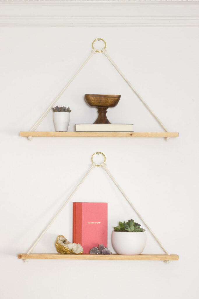 Learn how to make these DIY hanging rope wall shelves, plus see what tools were used to make it easy to hang them straight and level!