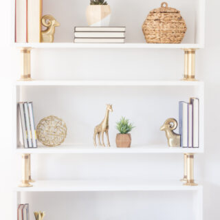 "Learn how to build this ""modern glam"" DIY pipe bookshelf!"