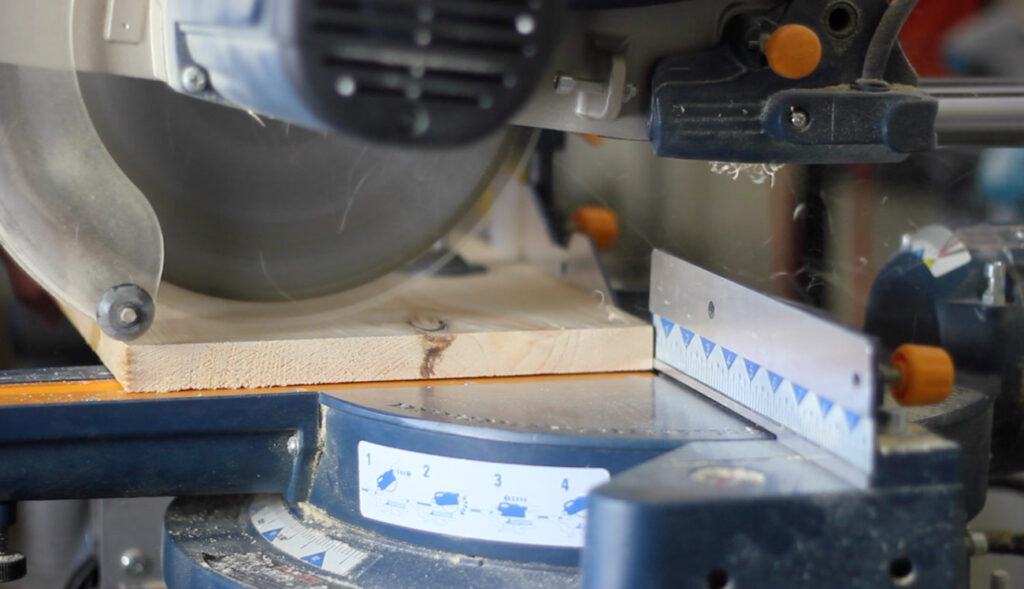 Cutting wood with a miter saw.