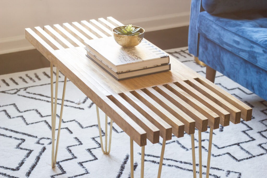 Learn how to make this DIY slatted coffee table with hairpin legs! This step by step tutorial will show you how. #diy #woodworking #diyfurniture