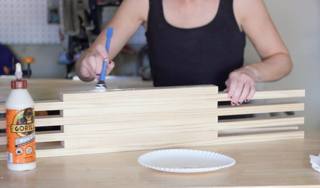 Erin Spain building a DIY slatted coffee table.