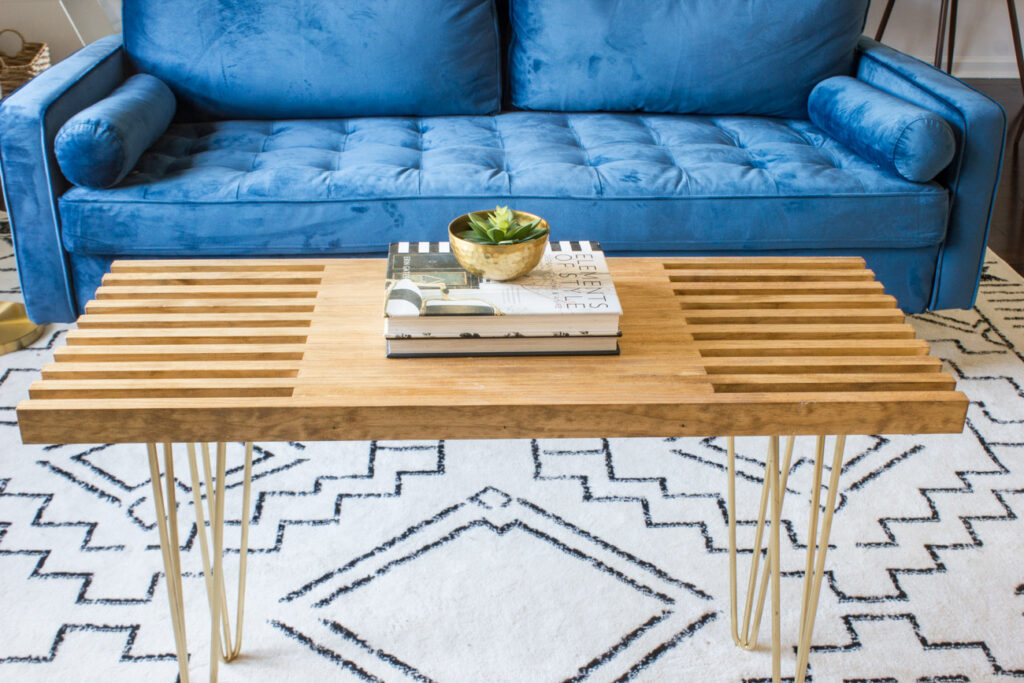 DIY slatted coffee table with gold hairpin legs.