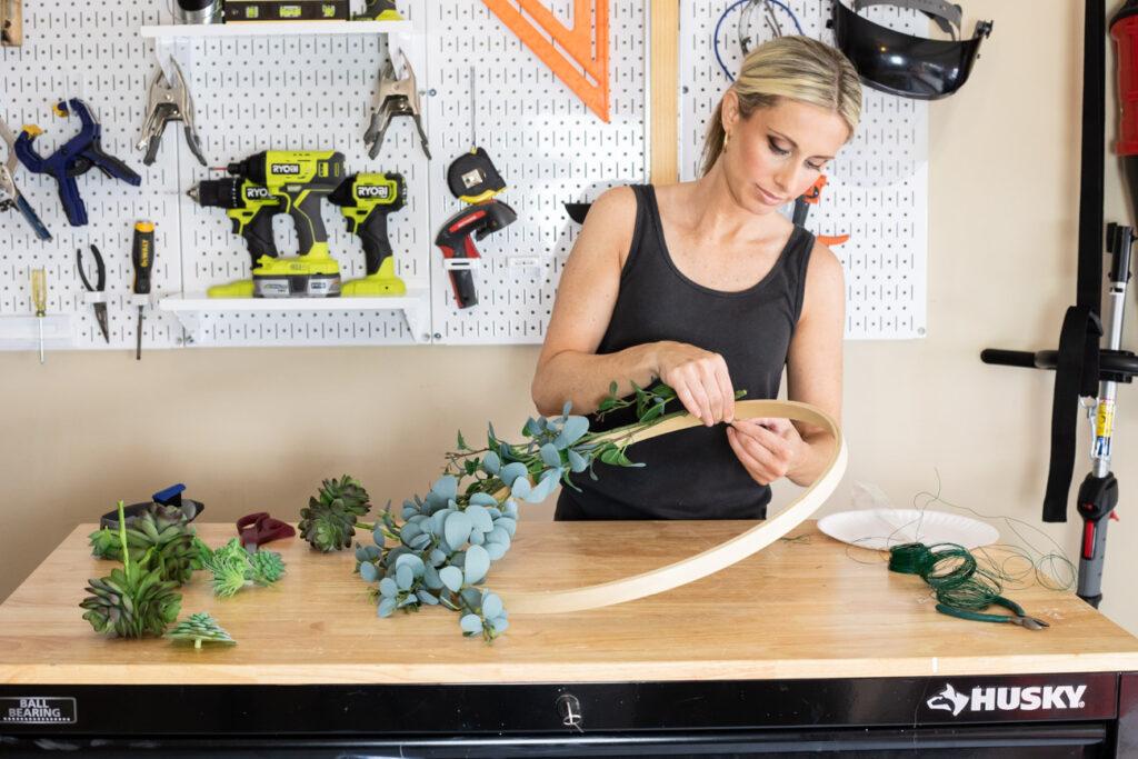 Erin Spain making a DIY summer wreath