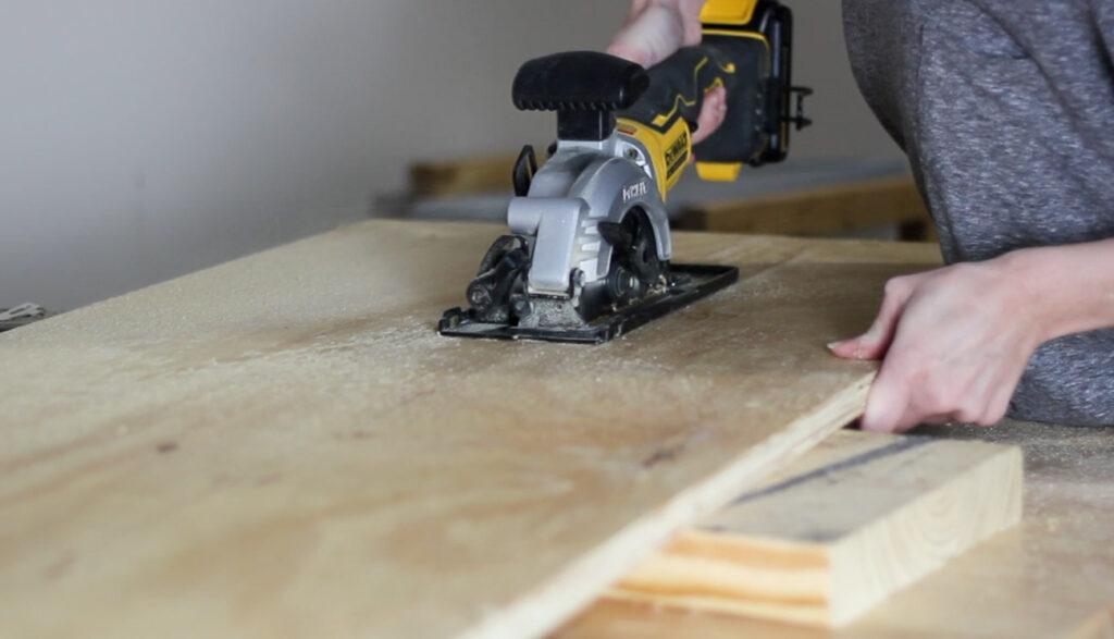 Cutting plywood with a handheld circular saw.