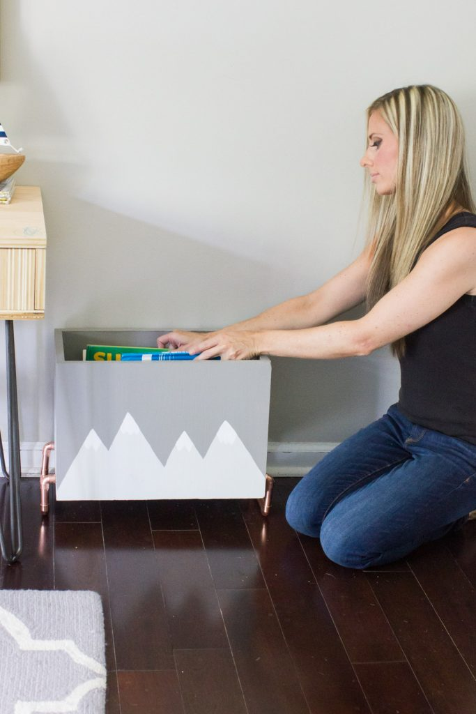 Learn how to make this hand painted wood and copper kid's book storage bin!