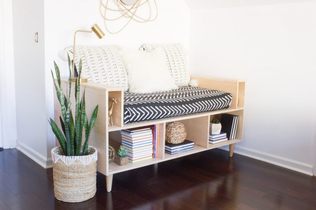 Upcycle your old crib mattress by building this DIY plywood mini daybed! This step by step tutorial will show you how.