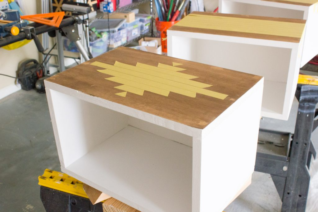 Learn how to build this DIY Aztec patterned storage bench!
