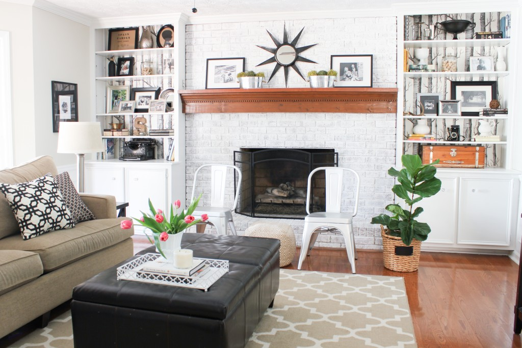 Neutral Family Room decor with whitewashed brick fireplace