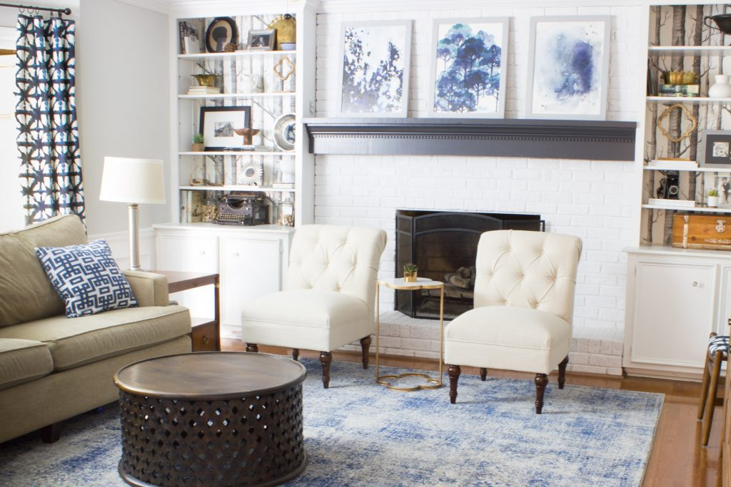 In love with these abstract art prints from Minted above the mantel in this family room.