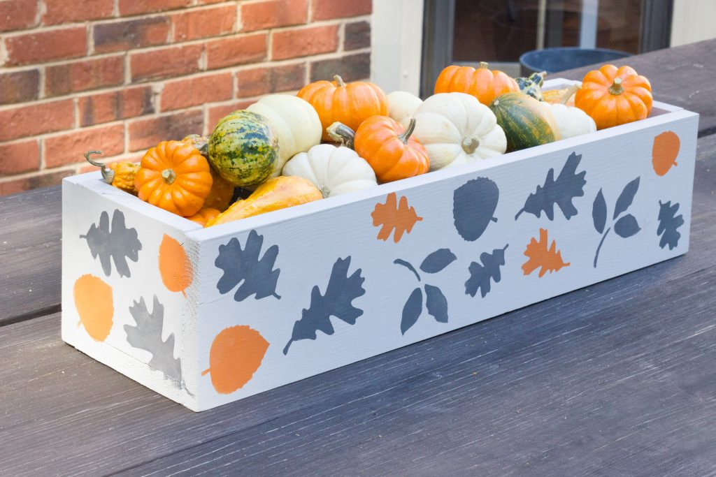Check out this pretty stenciled fall centerpiece! It's painted with FolkArt Home Decor Chalk. So pretty!