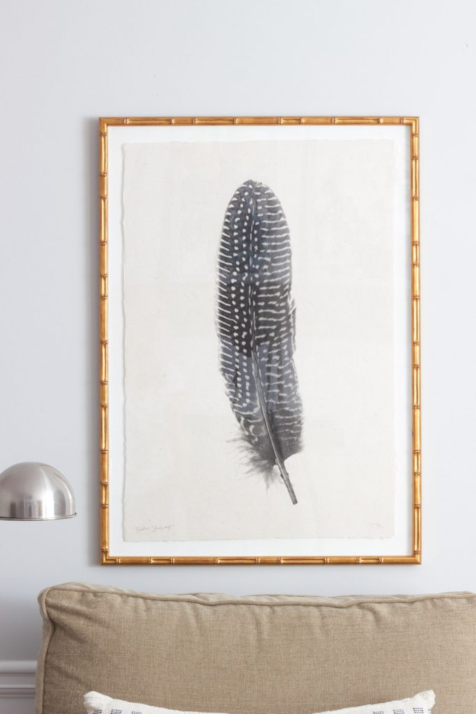 I absolutely love this gold Mandalay frame from Framebridge! This feather art was custom framed and featured in our family room makeover.
