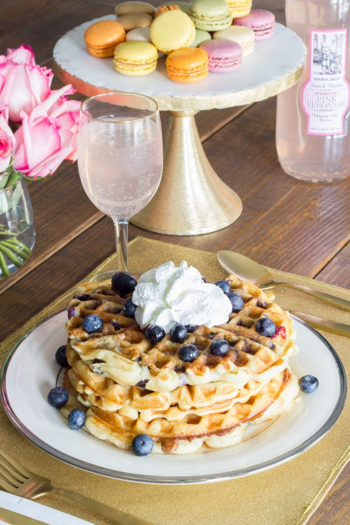 "LOVE this idea! ""Galentine's Day"" was introduced on the show Parks and Recreation. The main character, Leslie Knope, hosts a brunch for her gal pals every year the day before Valentine's Day. Waffles are her favorite food, so this Galentine's Day brunch featuring blueberry waffles is perfect!"