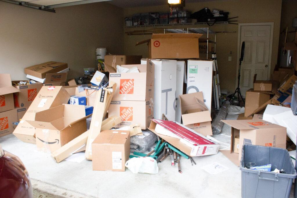 Cluttered garage before makeover