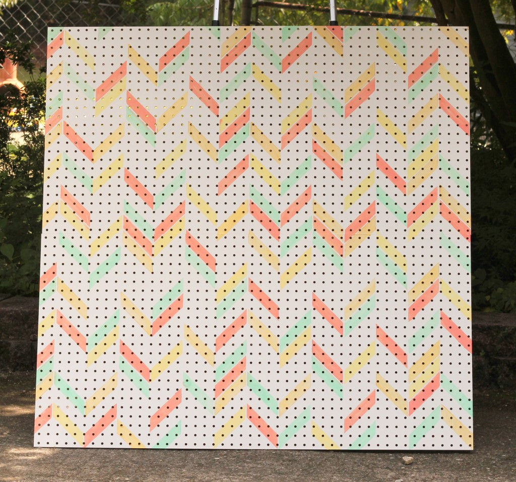 Herringbone stenciled pegboard for a girly garage workshop.