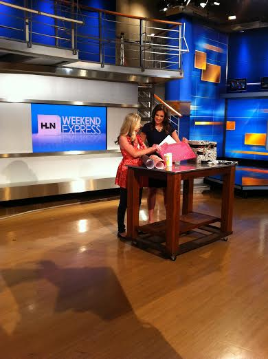 Erin Spain and Lynn Berry filming a segment for HLN Weekend Express