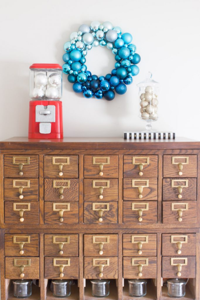 Seriously obsessed with this ombré ornament wreath! And the card catalog and vintage gumball machine are gorgeous too.