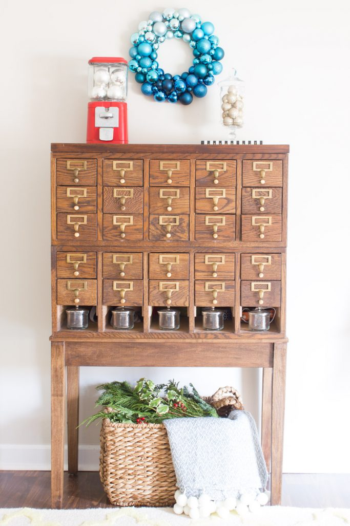 This ombre blue ornament wreath from Home Decorators Collection is gorgeous! Loving the card catalog and gumball machine filled with ball ornaments too.
