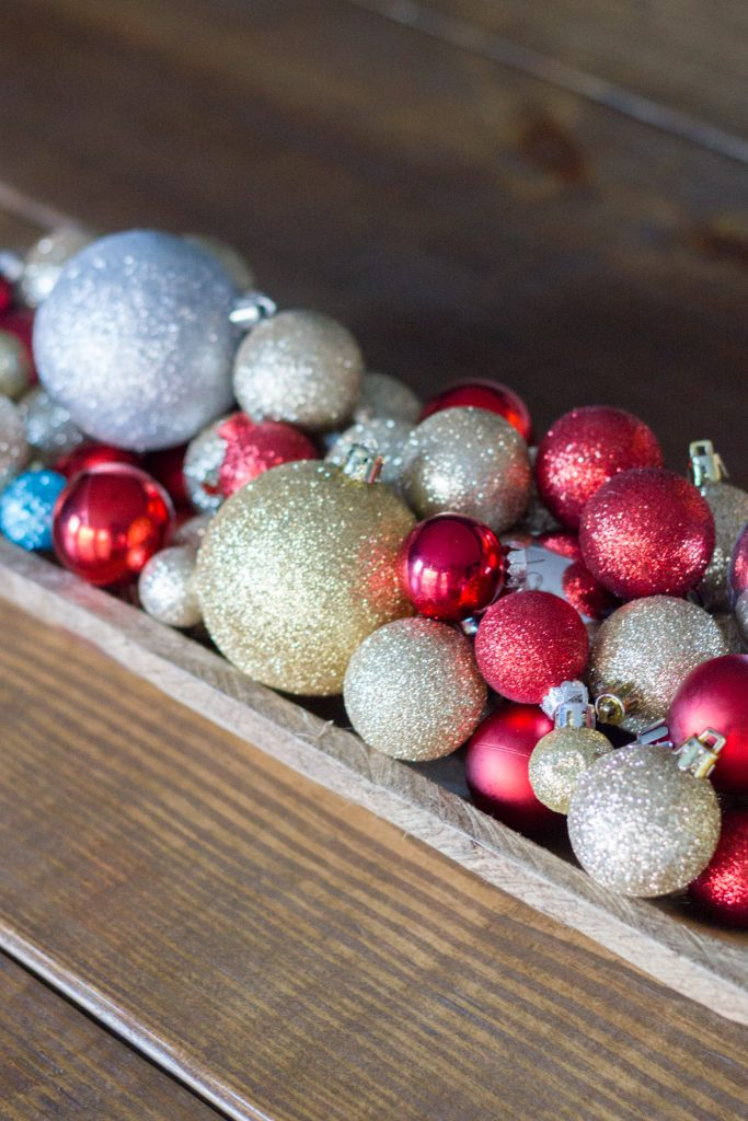 Glittery ball ornaments in a dough bowl makes for easy holiday decor.