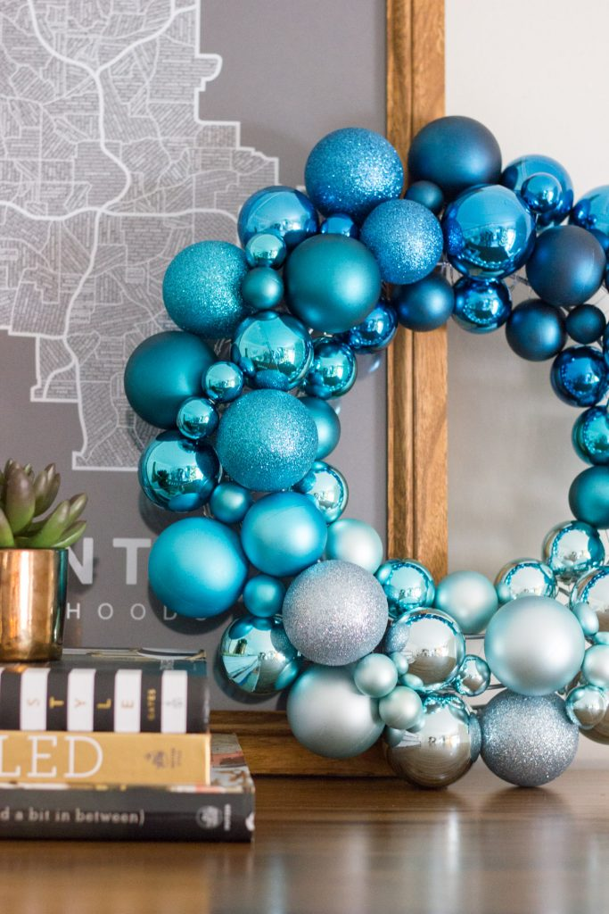 I love this simple, modern holiday vignette with an ombre wreath.