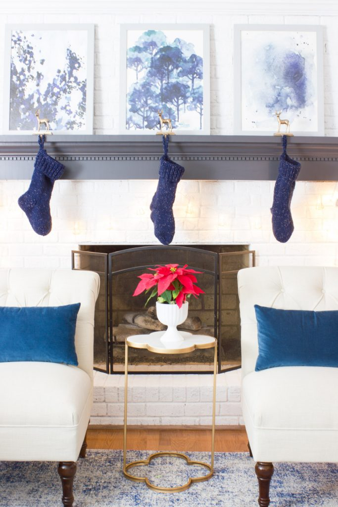 This family room decked out in blue with pops of red is gorgeous for the holidays!