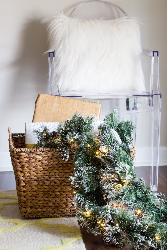 This glittery garland from Home Decorators Collection is the perfect addition to any holiday decor. Love the ghost chair and faux fur pillow too!