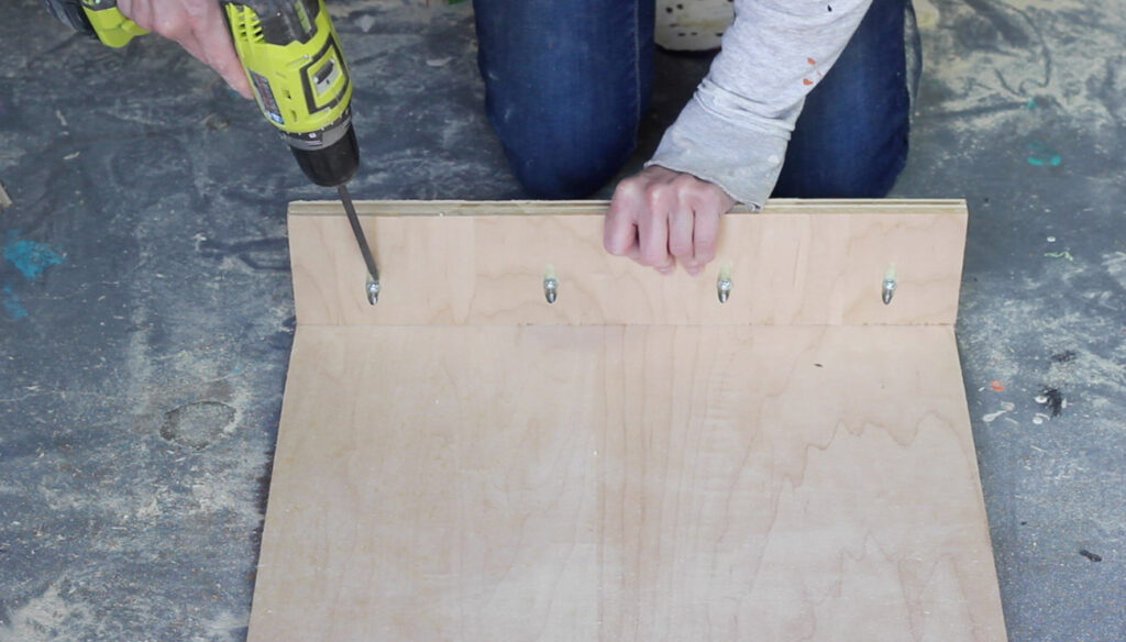 Learn how to make a DIY plywood coffee table with diamond patterned plywood panels that attach with magnets and reveal hidden storage!