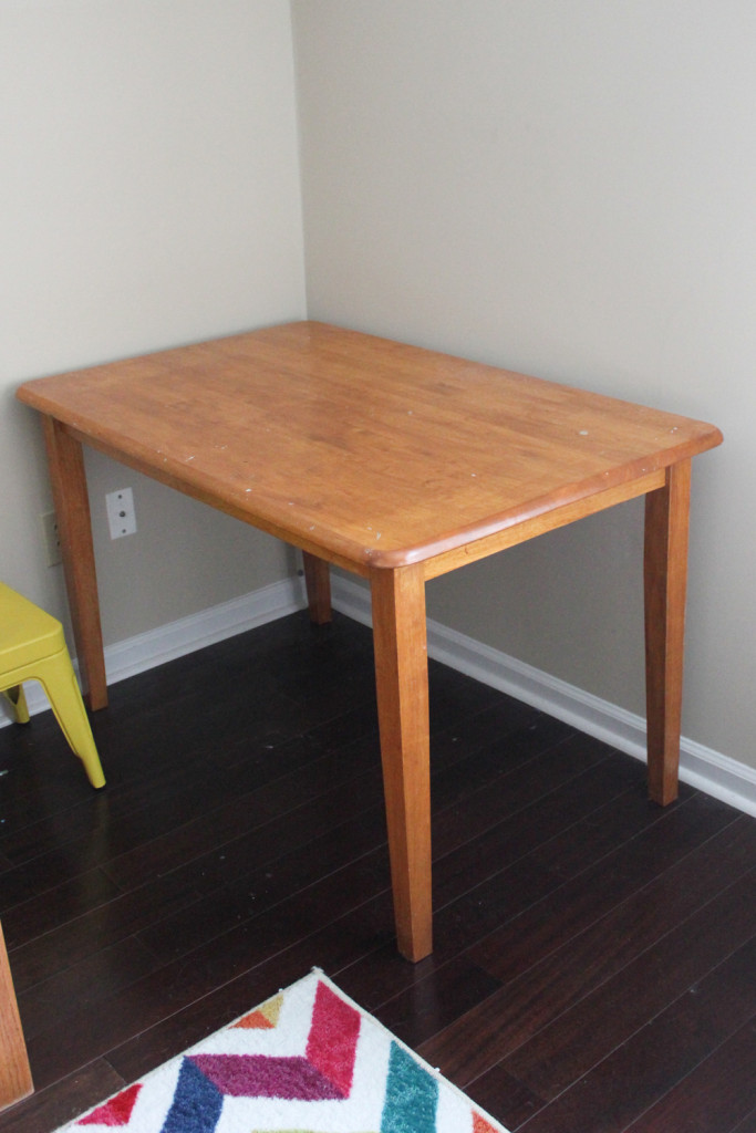 Thrift Store Challenge: Old dining table becomes cute kids' art table.
