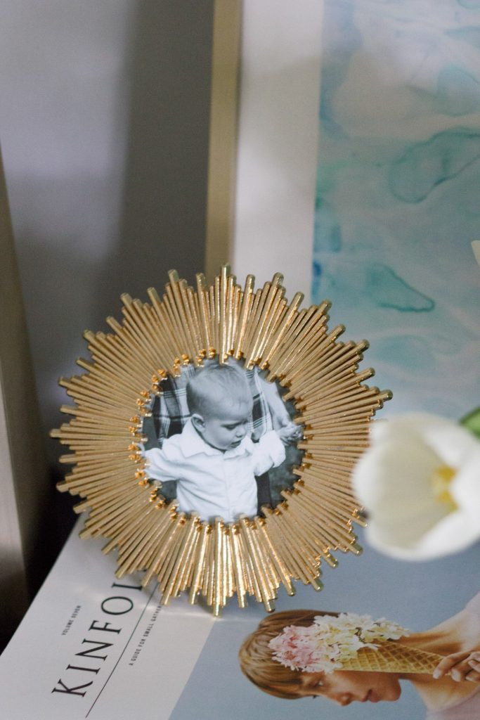 This small gold frame with a black and white photo pops in this nightstand vignette in the master bedroom made over for the One Room Challenge.