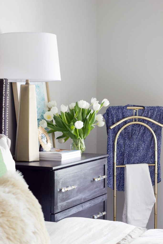 A vintage brass valet stand and a custom IKEA hack nightstand dress up this corner of a beautiful master bedroom made over for the One Room Challenge.